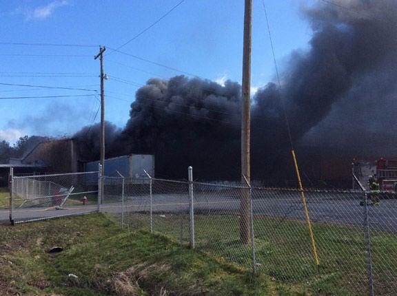 Black smoke from burning plastics and foam