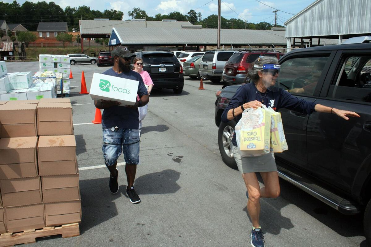 McElhone helps with food giveaway