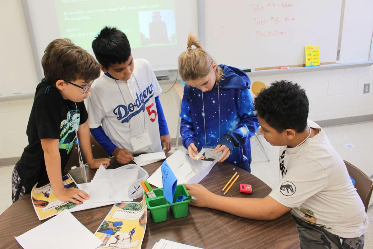 Kids work on STEM projects at RCS Young Scholars program