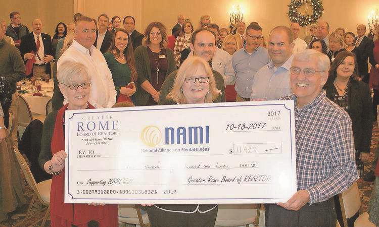 Realtors honor local agents, present check to mental illness group NAMI