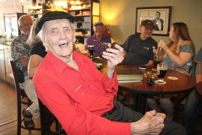 WW II veteran celebrates 96th birthday with a pipe and pint File