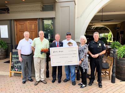 Branch & Barrel donates check