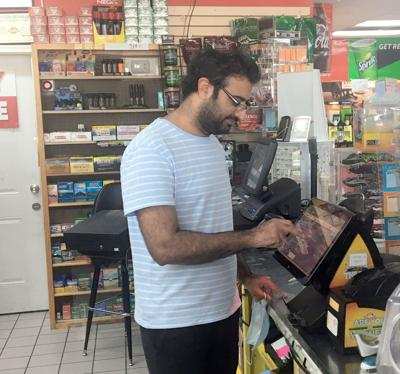 Chaudhry Hafeez punches out a lottery ticket