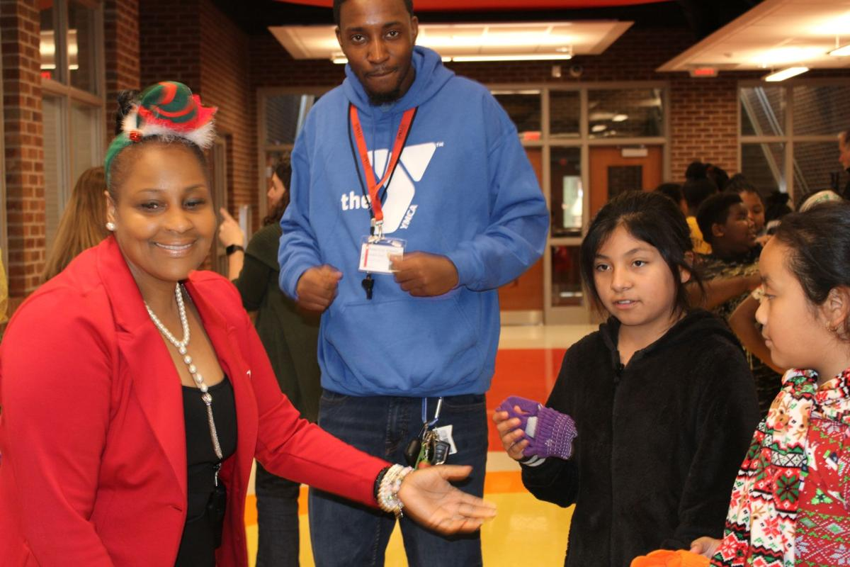 Principal gives 420 coats at Anna K. Davie