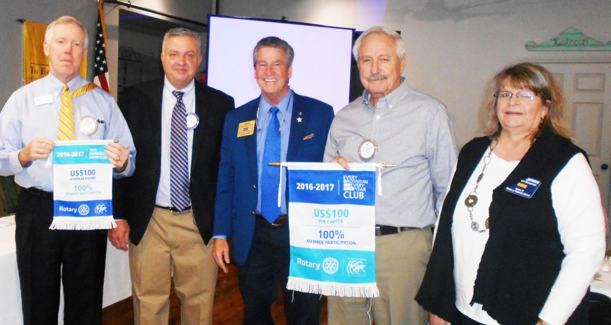District Governor presents achievement banners to local Rotary