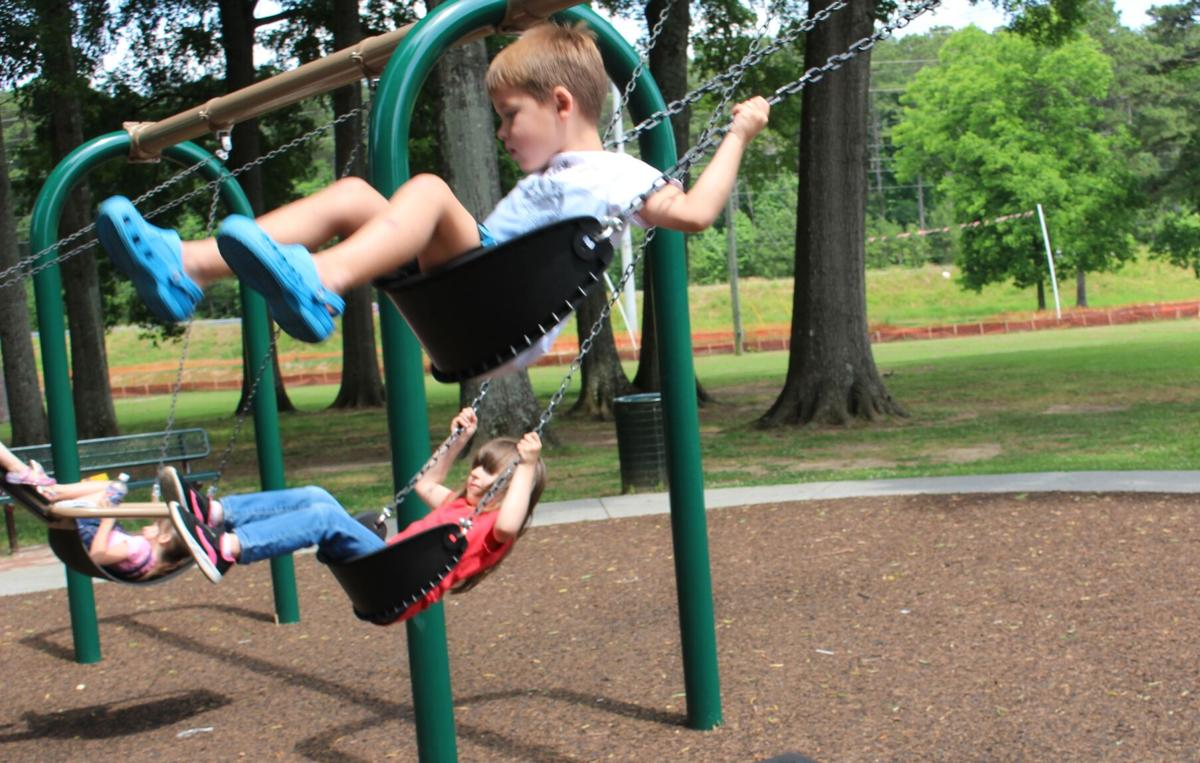 Kids enjoy sunny skies at Ridge Ferry Park before rain moves in for the rest of the week