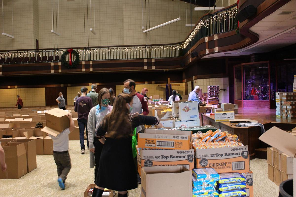 First Presbyterian Church distributes more than 600 boxes of food to needy local families