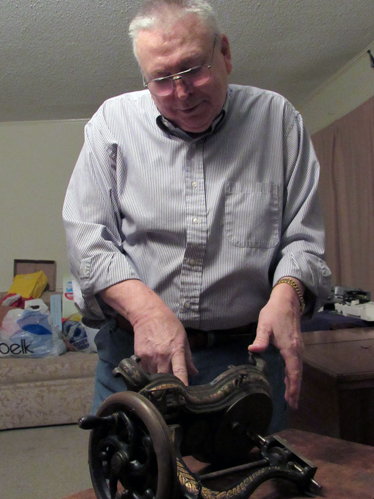012818 Photo by Michelle Wilson - Rick Hastings with a hand crank sewing machine from the 1800s..jpg