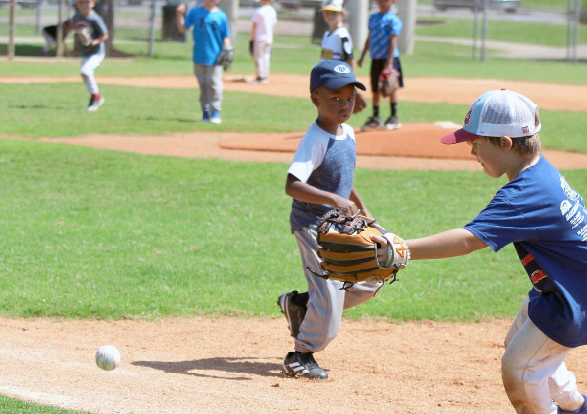 Summer baseball fundamentals camp continues behind the levee
