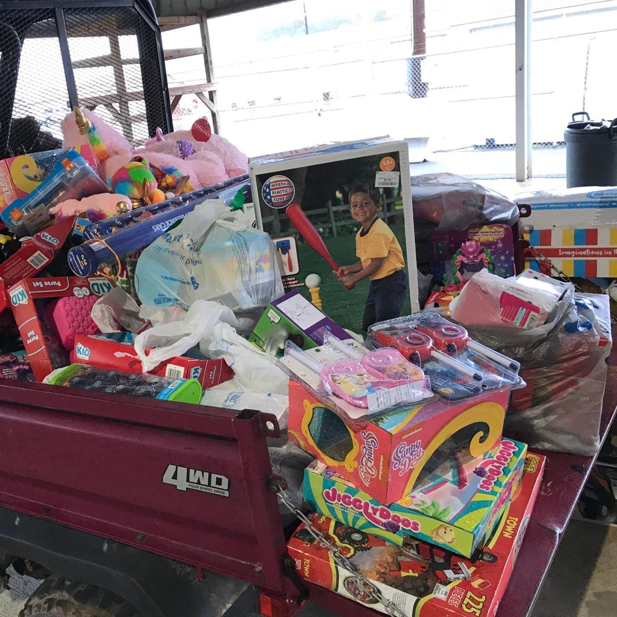 Freedom Seekers donate toys, cash to Toys for Tots