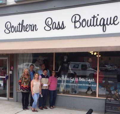DCA check presentation to Southern Sass Boutique