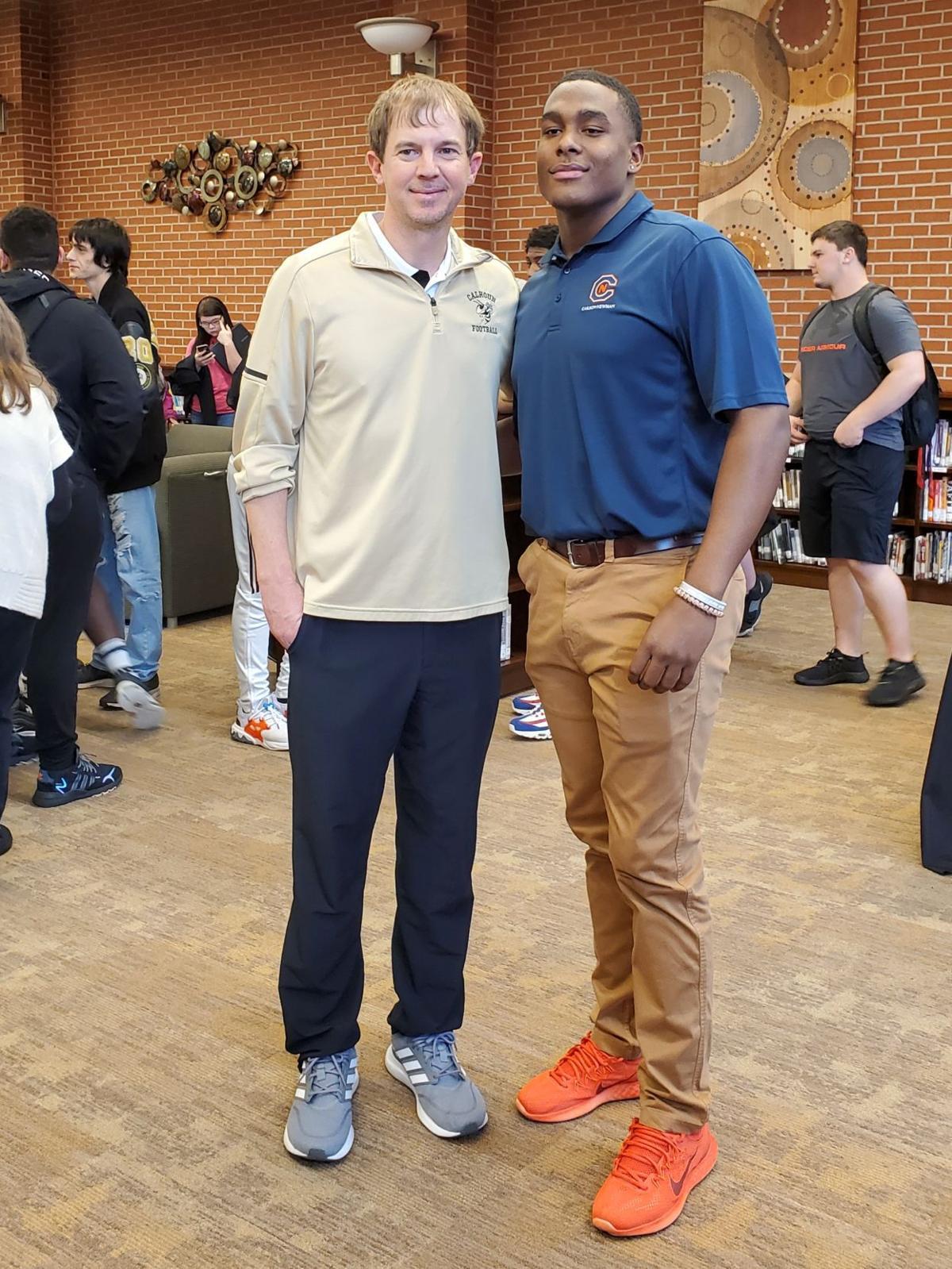 Kendez Griffin with Calhoun Football head coach Clay Stephenson