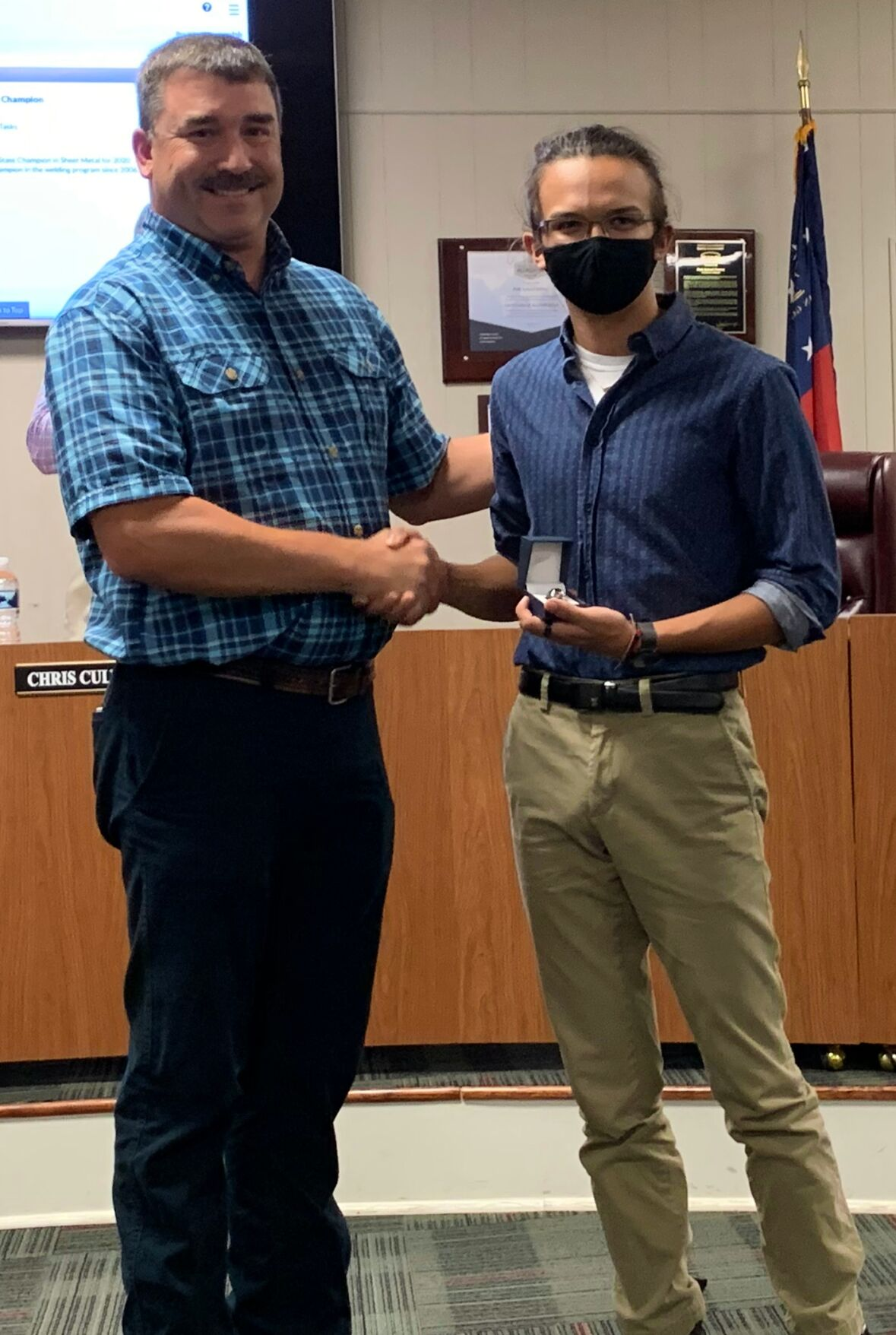 School board recognizes student, employee at meeting