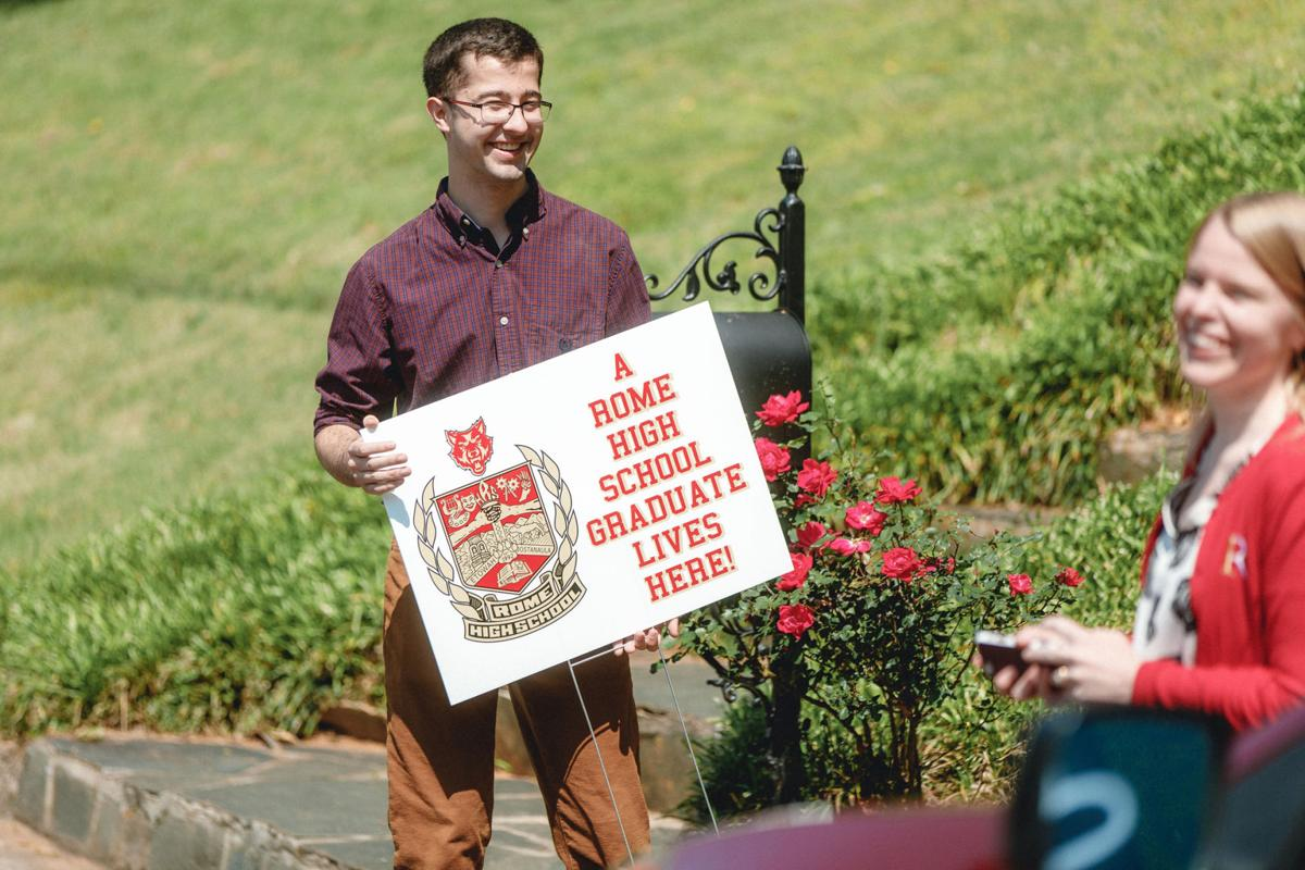 Rome High School graduates surprised with yard signs