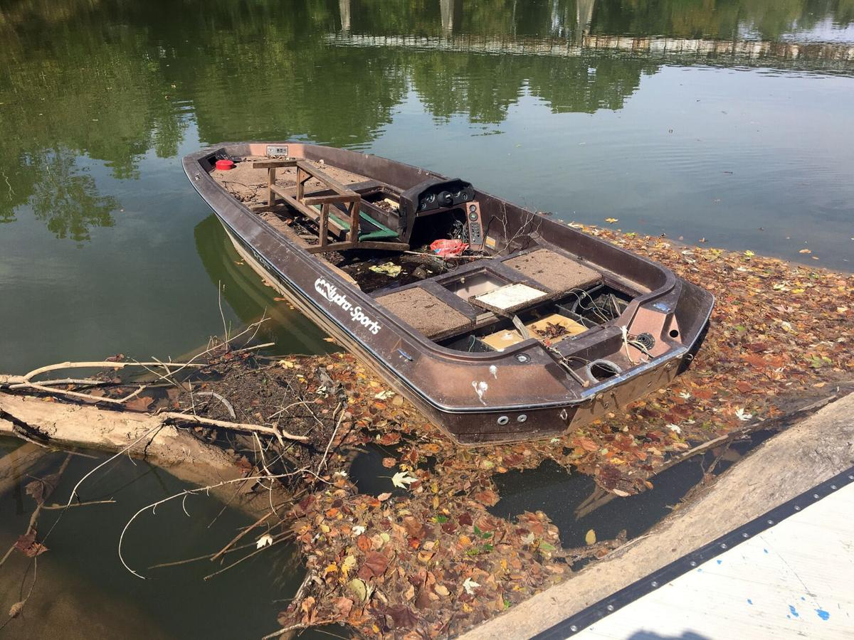 Abandoned bass boat gets hung up on a dock at Ridge Ferry Park
