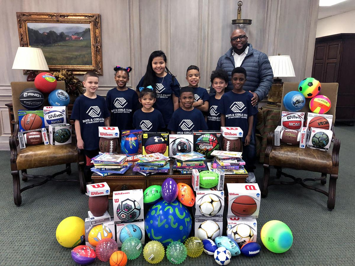 Books and balls a hit with Boys & Girls Club
