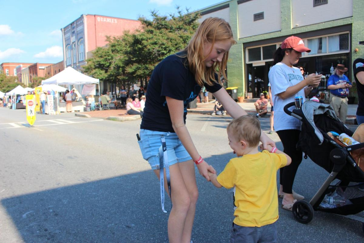 Sunshine, fiddlin' and squaredancing: Fiddlin Fest sees large crowd in Downtown Rome