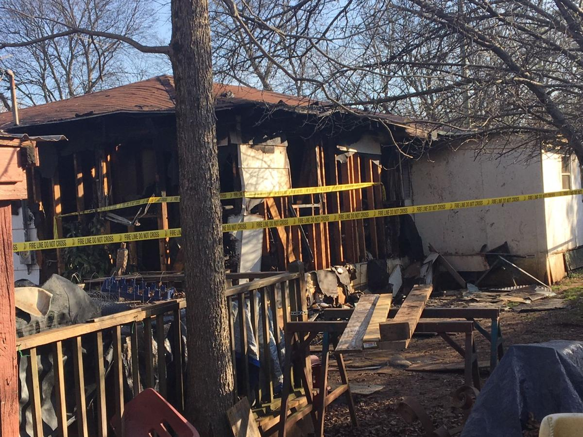 Two dead, two injured in house fire