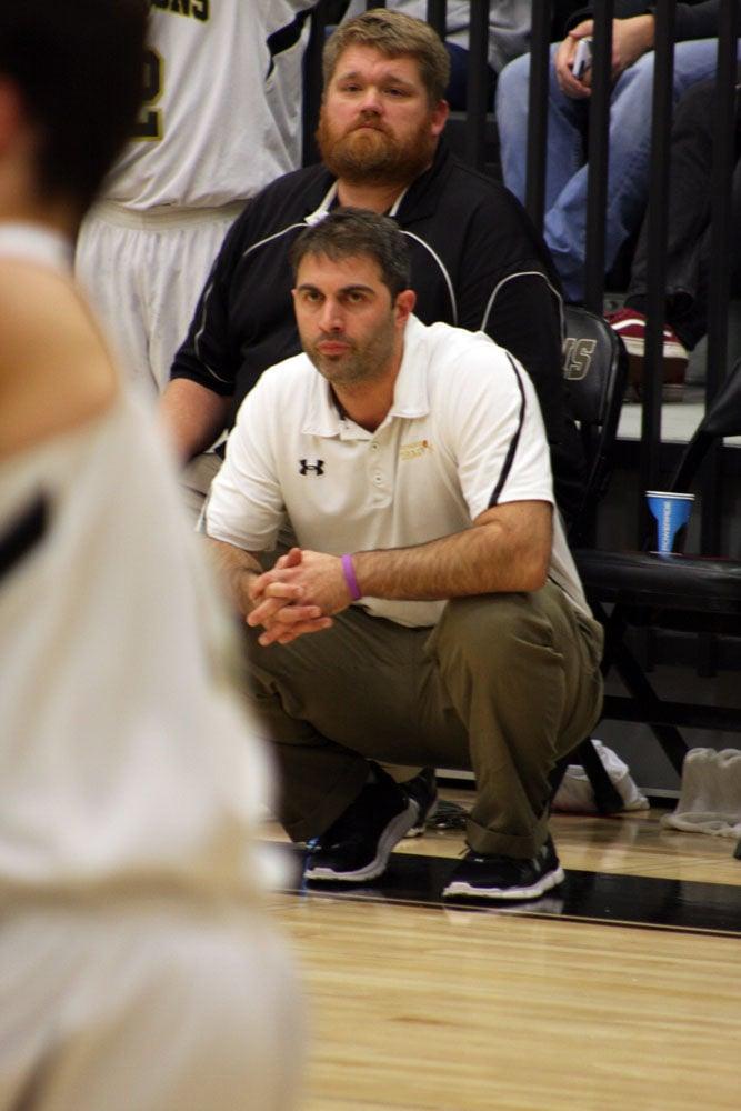Coach Zach Mendence