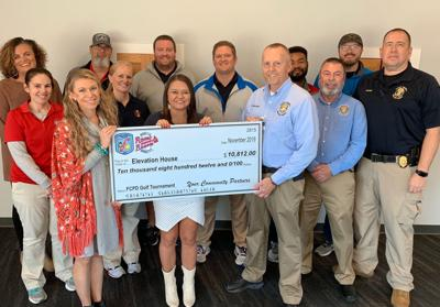 FCPD, Rome Braves present check to Elevation House