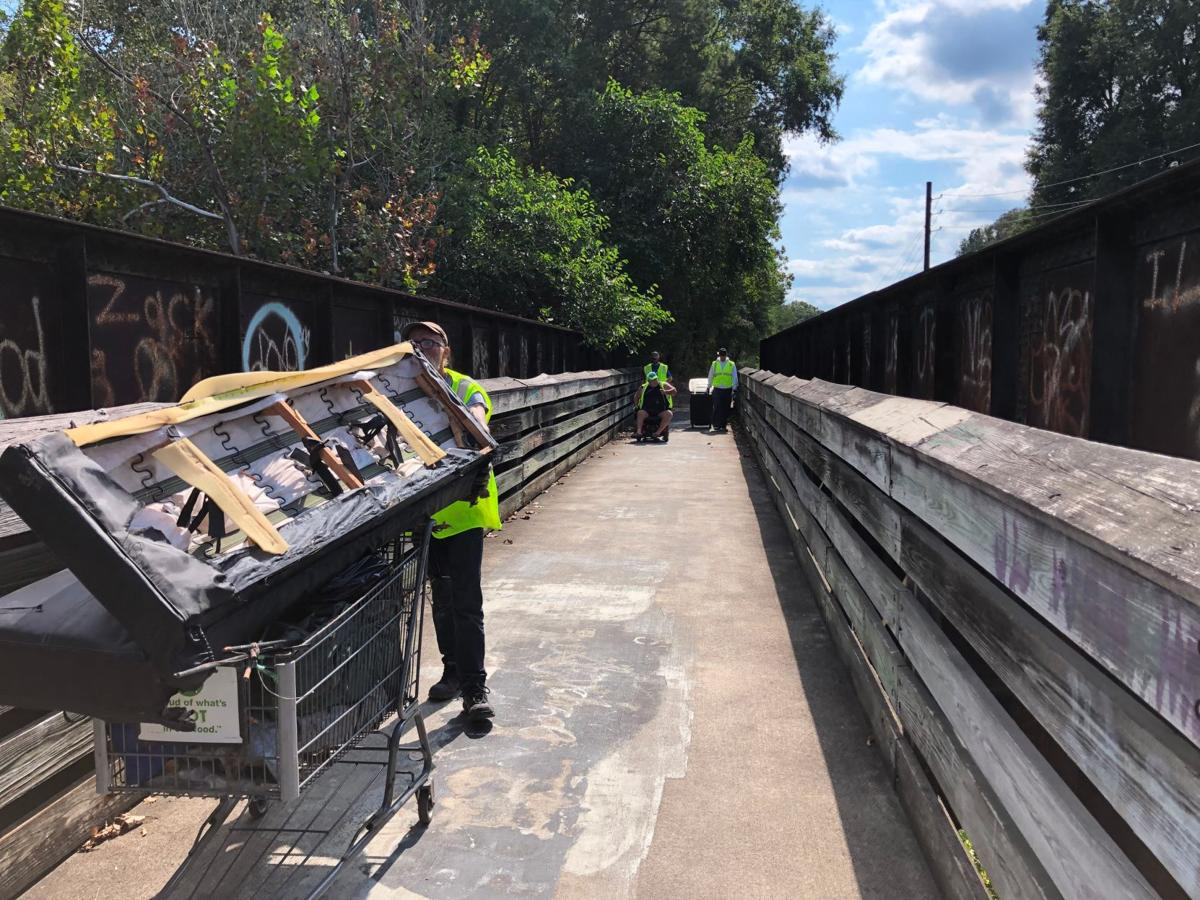 Homeless help haul trash from woods along Silver Creek Trail