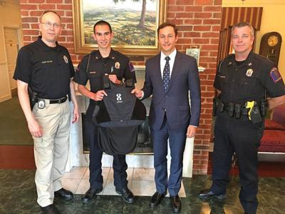 Funeral home donates police vest