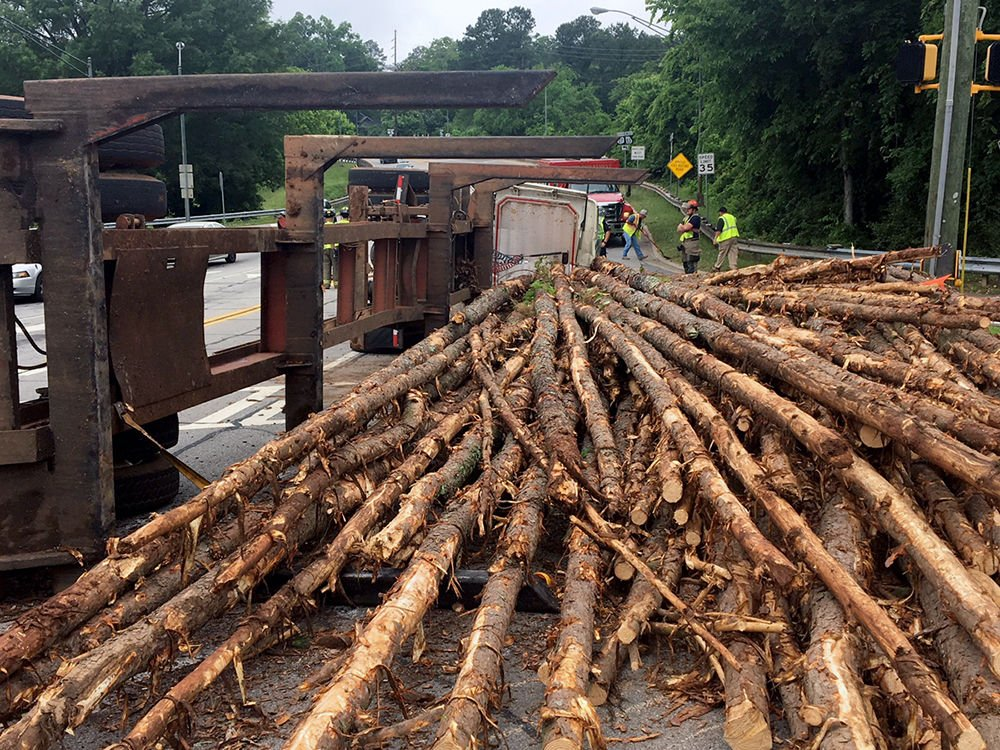 Logging truck roll over makes major mess on East 12th