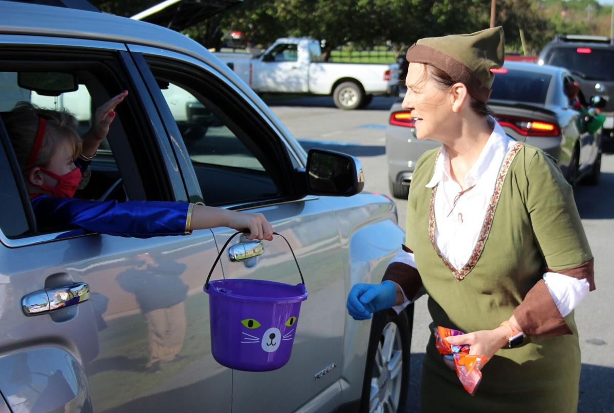 Rockmart city employees hold drive-thru trick or treating