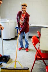 Students donate muscle to keep Barron Stadium clean