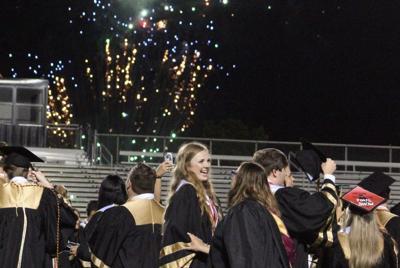 Rockmart graduates wait out rain for ceremony