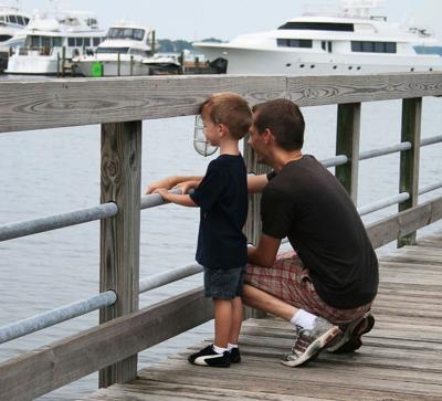 Dad and son looking out on harbor