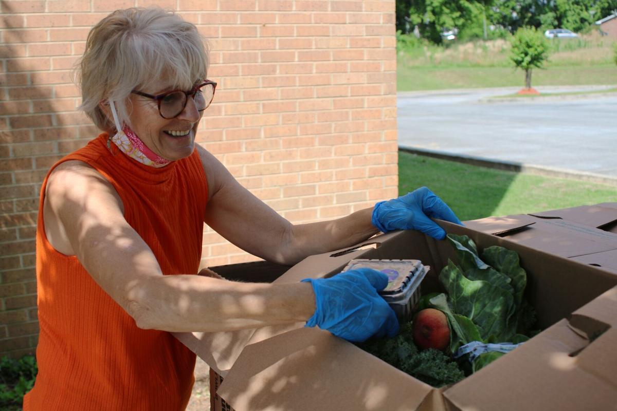 "YMCA helps distribute ""Grab & Go"" Meals"