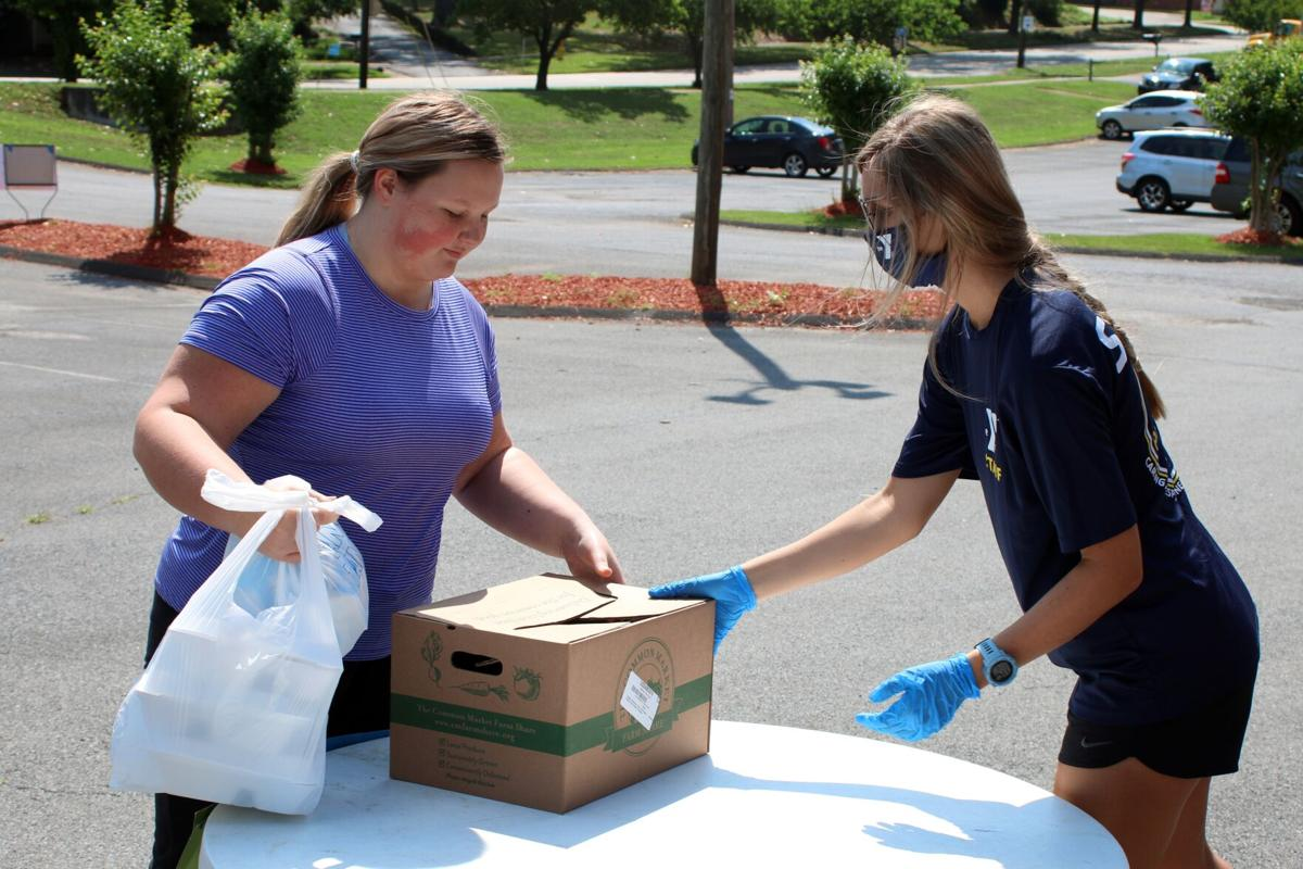 """YMCA helps distribute """"Grab & Go"""" Meals, fresh produce"""
