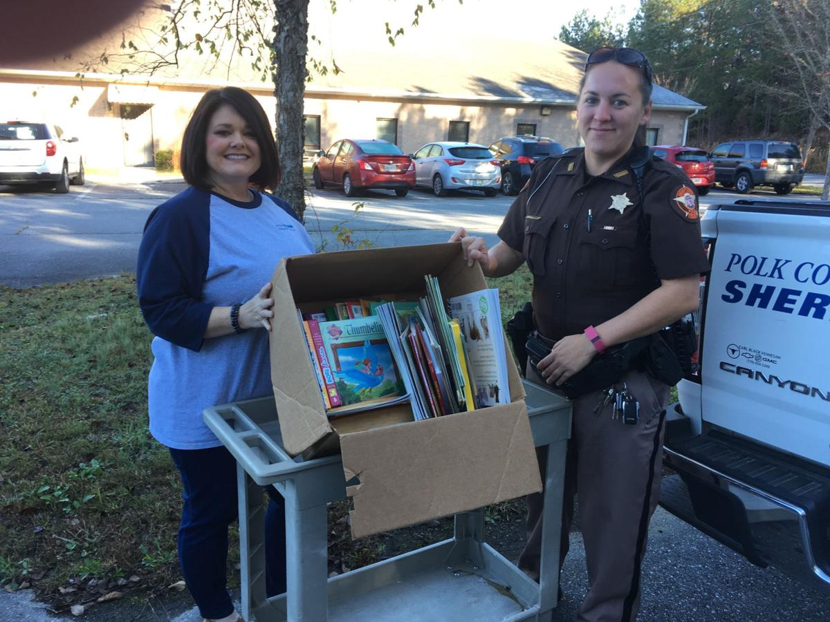 Sheriff's Office gives books for DFCS youth