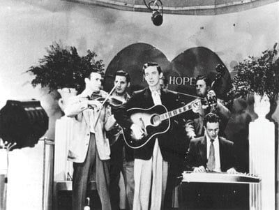 Tommy Jackson plays with country music legends