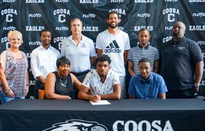 Kenon Dixson inks basketball scholarship with Lewis and Clark Community College