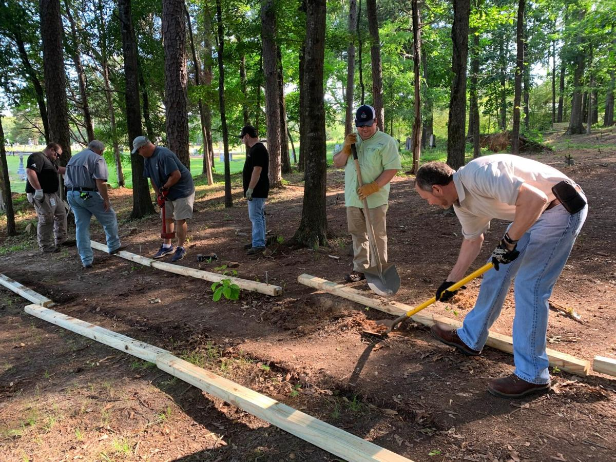 Georgia Power workers do trail work in historic black cemetery at Euharlee