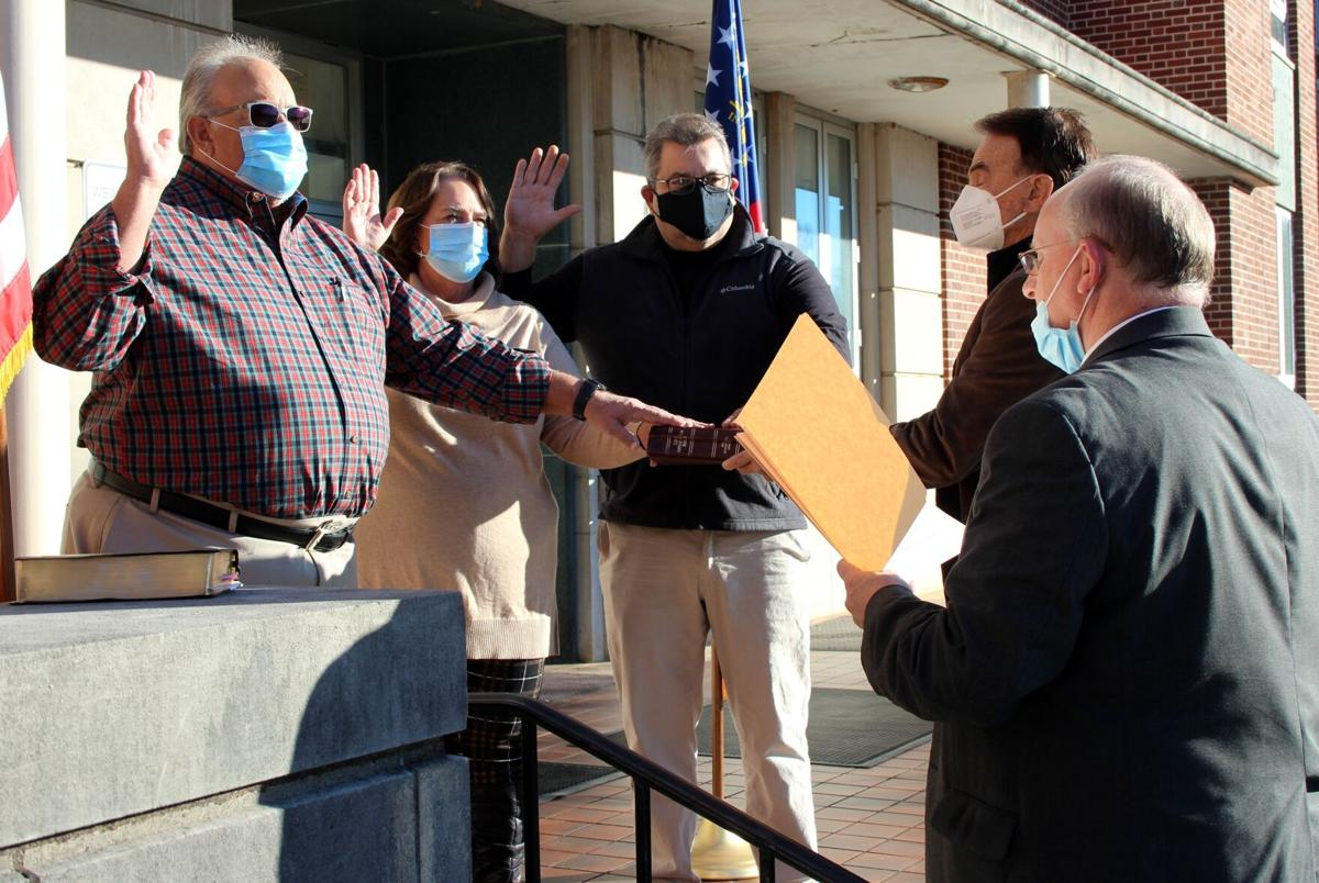 County commissioners, new tax commissioner sworn in