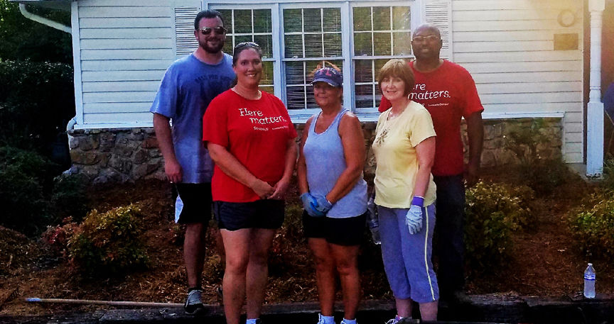 Synovus Bank volunteers make improvements to the Winner's Club of Calhoun