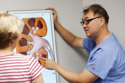 Dr. Hak Lee with a patient