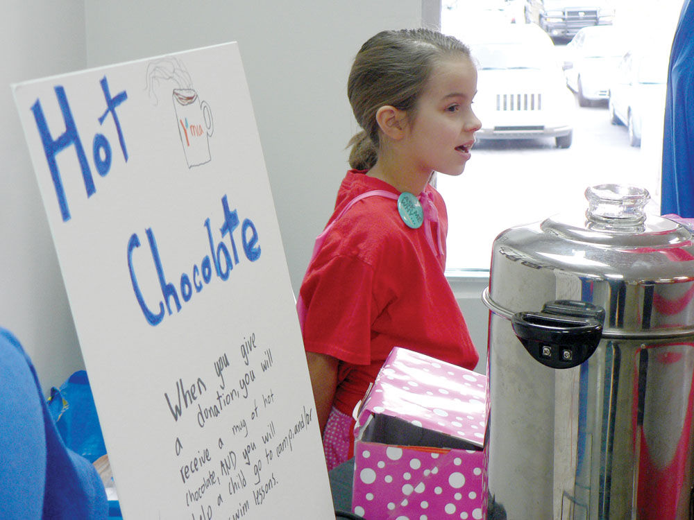 8 Year Old Serves Hot Chocolate To Fund Children S