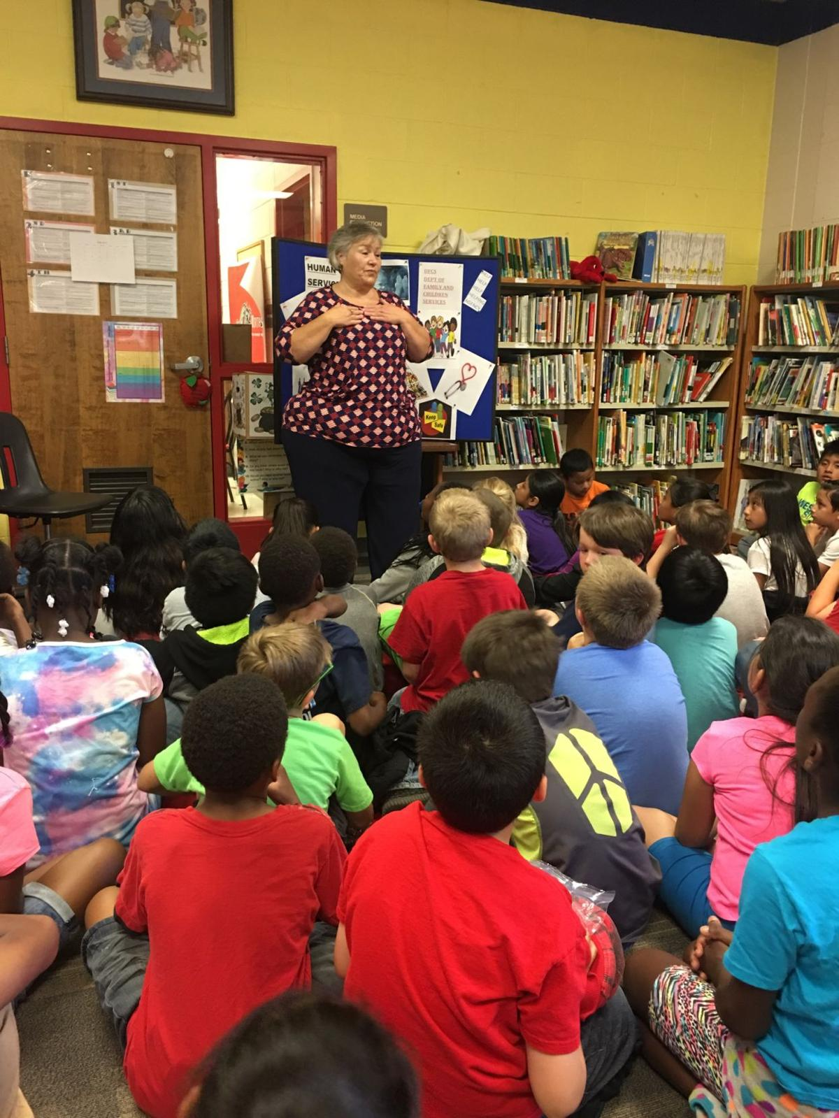Robin Forston speaks to third-graders about DFCS