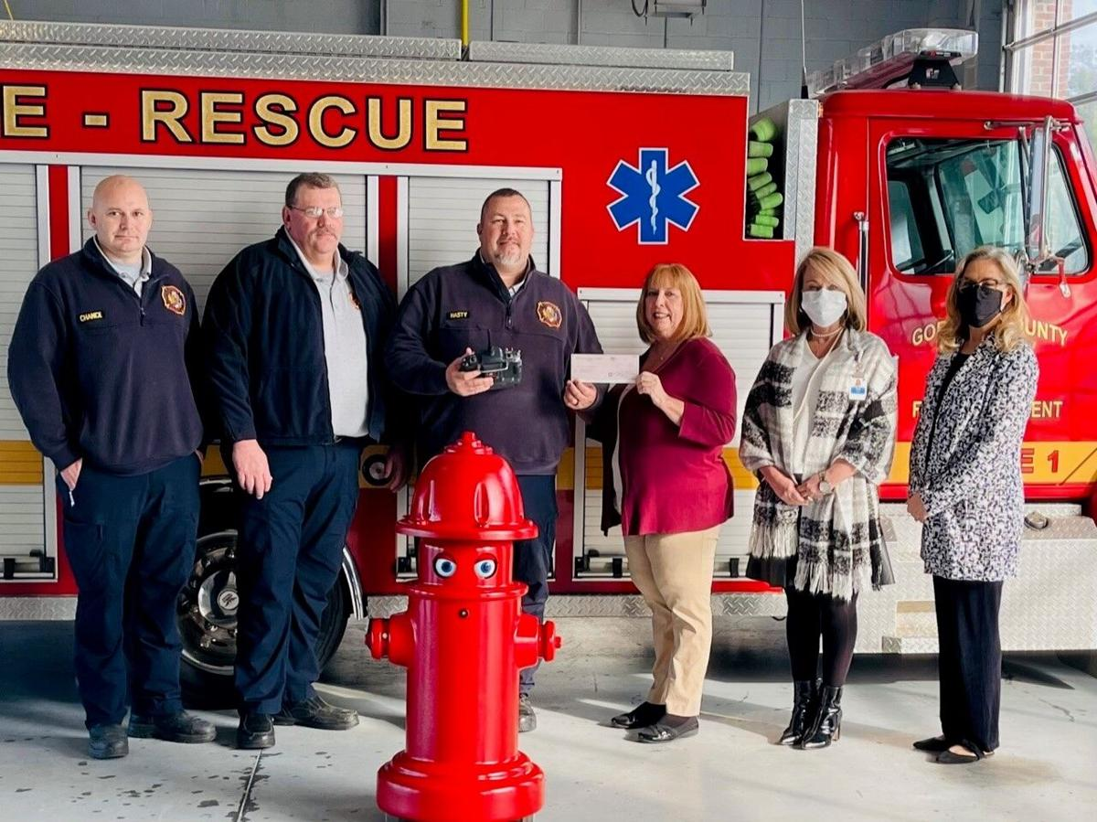 Drugs Don't Work Task Force presents Fire and Rescue with educational robot
