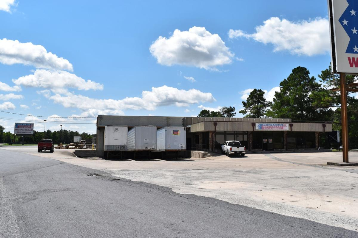 Carden Wholesale, old Michael's Carpet buildings sell