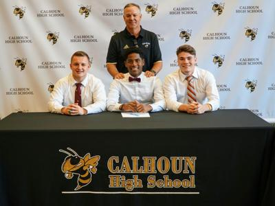 Three Calhoun Football players sign to compete at next level