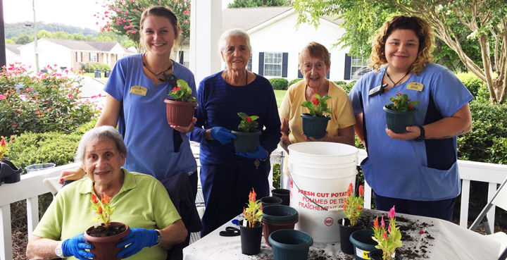 Morning Pointe residents plant flowers to give away to RAs