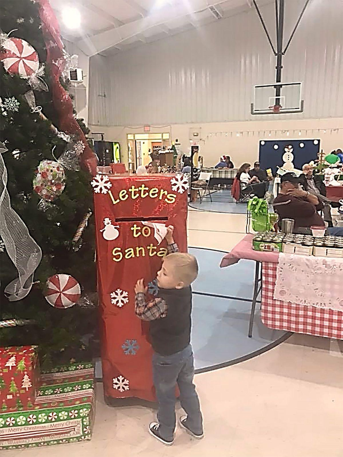 Catoosa Parks and Recreation boy mailing letter to Santa