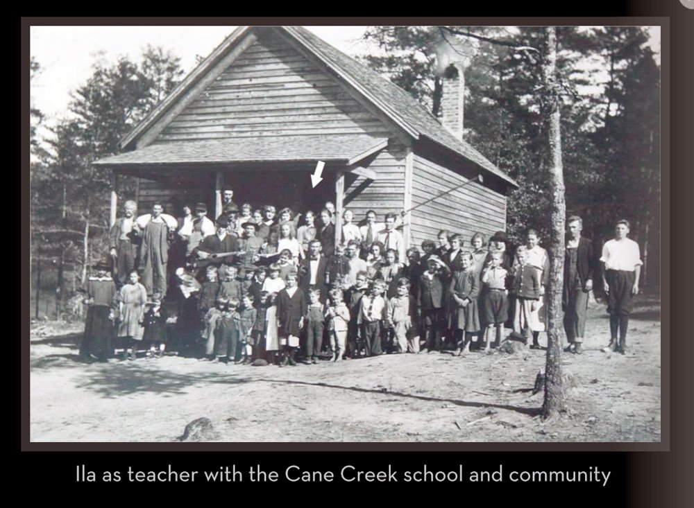 Community school photo - Ila Arminda Stargel identified by arrow.  She was the teacher at this one-room schoolhouse in Cane Creek, near Dalohnega.jpg