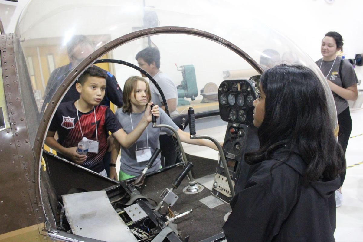 Young Scholars participants travel to the airport to learn about aviation