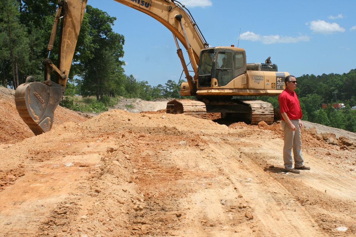 Evans leveling mountainside on U.S. 411 for future development